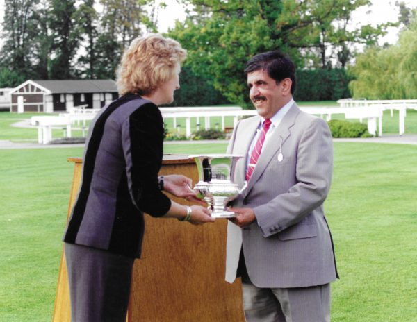 Sheikh Hamdan receiving the trophy for Normativ from Georgie Moore, Chairman of the Racing Committee